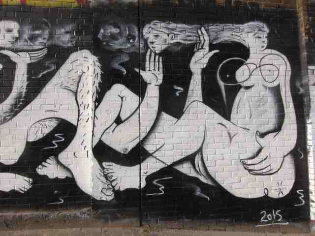 mural, two women and a hairly leg
