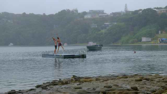 Men on pontoon about to dive into sea