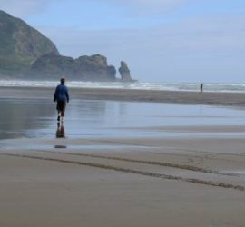 Lone figure on Piha Beach
