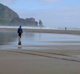 Lone figure on Piha Beach