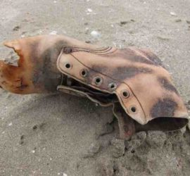 Old boot in the sand